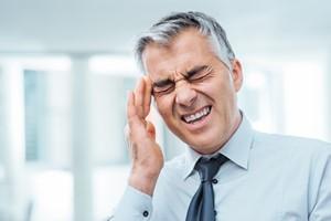 Ciągły ból głowy? Przyczyn możesz szukać w ustach [© StockPhotoPro - Fotolia.com]