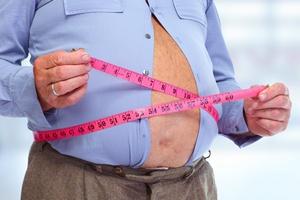 Otyłość to wyższe ryzyko aż jedenastu nowotworów [© Kurhan - Fotolia.com]